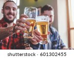 two bearded hipsters clinking... | Shutterstock . vector #601302455