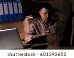 young businessman working late... | Shutterstock . vector #601393652
