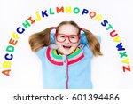 happy preschool child learning... | Shutterstock . vector #601394486