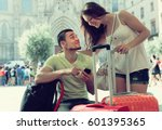 happy young couple in shorts... | Shutterstock . vector #601395365