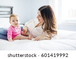a mother and baby child on a... | Shutterstock . vector #601419992