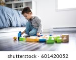 a cute child playing with color ... | Shutterstock . vector #601420052