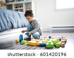 a cute child playing with color ... | Shutterstock . vector #601420196