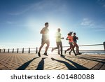 young people running along a... | Shutterstock . vector #601480088
