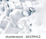 Wedding rings on a satiny fabric with bows - stock photo