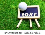 """Small photo of Fore wording with golf ball are on green grass. """"Fore!"""", originally an Australian interjection, is used to warn anyone standing or moving in the flight of a golf ball."""