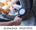 close up mechanic inflating... | Shutterstock . vector #601672952
