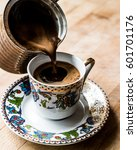 Pouring Turkish Coffee Into Th...