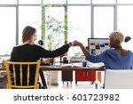 fist bump corporate colleagues... | Shutterstock . vector #601723982