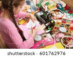 girl sews doll clothes  top...   Shutterstock . vector #601762976