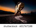 sneaker marking a footprint on ... | Shutterstock . vector #601767188
