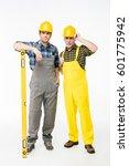 two workmen in helmets standing ...   Shutterstock . vector #601775942