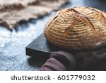 round loaf of freshly backed...   Shutterstock . vector #601779032