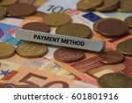 Small photo of payment method - the word was printed on a metal bar. the metal bar was placed on several banknotes