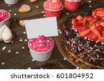 pink cupcakes on wooden table... | Shutterstock . vector #601804952