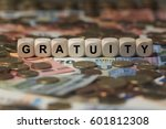 Small photo of gratuity - cube with letters, sign with wooden cubes