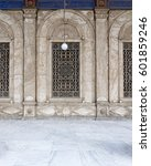 Small photo of Three adjacent arched windows with decorated iron grid over white marble decorated exterior wall at the Mosque of Muhammad Ali Pasha (Alabaster Mosque), Citadel of Cairo, Egypt