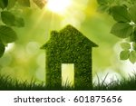 grass house symbol over green... | Shutterstock . vector #601875656