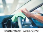hand cleaning the car interior... | Shutterstock . vector #601879892