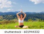beautiful young girl doing yoga ... | Shutterstock . vector #601944332