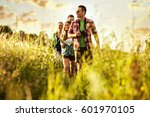 group of young friends hiking... | Shutterstock . vector #601970105