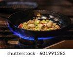 chef in restaurant kitchen... | Shutterstock . vector #601991282