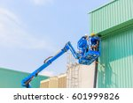 worker man on a scissor... | Shutterstock . vector #601999826