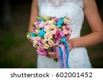 in the hands of the bride is a... | Shutterstock . vector #602001452