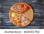 cut pieces of pizza with... | Shutterstock . vector #602031782