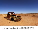 Rusted Car Hood In The African...