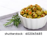 bowl of green olives stuffed... | Shutterstock . vector #602065685