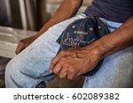 hands of an undocumented worker ... | Shutterstock . vector #602089382