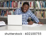 in the library   handsome...   Shutterstock . vector #602100755