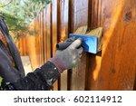painting a wooden garden fence | Shutterstock . vector #602114912