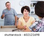serious retiree couple having... | Shutterstock . vector #602121698