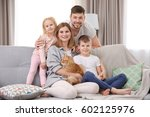 parents with children and cat... | Shutterstock . vector #602125976