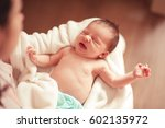 mother holding crying baby girl ... | Shutterstock . vector #602135972