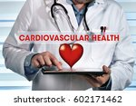 doctor holding tablet with the... | Shutterstock . vector #602171462