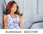 teenage girl using her mobile... | Shutterstock . vector #60217240