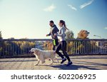 Stock photo fitness sport people and jogging concept happy couple with dog running outdoors 602206925