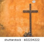 cross on a wall in rome | Shutterstock . vector #602234222
