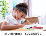 beautiful elementary schoolgirl ... | Shutterstock . vector #602250932