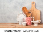 Stock photo kitchen utensils and tableware on wooden table over rustic background with copy space 602341268