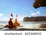 couple canoeing or kayaking at... | Shutterstock . vector #602368442