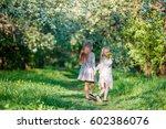 adorable little girls on spring ... | Shutterstock . vector #602386076
