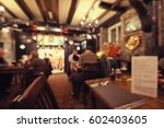 blurred old fashioned restaurant | Shutterstock . vector #602403605
