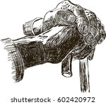 hand of a old man holding a... | Shutterstock .eps vector #602420972