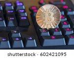 shining gold metal btc bitcoin... | Shutterstock . vector #602421095