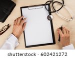 doctor's hands on a clipboard... | Shutterstock . vector #602421272