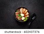 ramen soup on a black bowl over ... | Shutterstock . vector #602437376